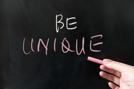 talent: Be unique words written on blackboard using chalk