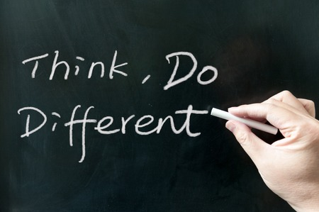 think different: Think, do different words written on the blackboard using chalk