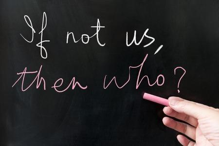 then: If not us then who words written on blackboard using chalk