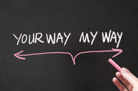 Your way vs my way conceptional words  written on blackboard using chalk