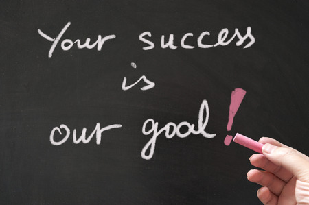 support: Your success is our goal words written on blackboard using chalk