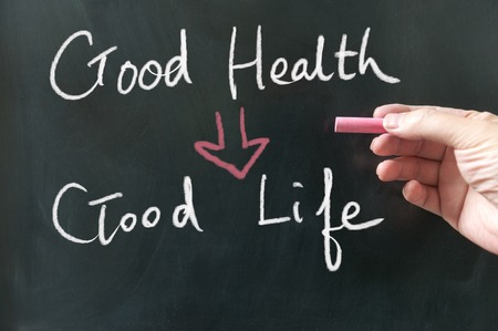 the good life: Good health to good life conceptional words written on blackboard using chalk