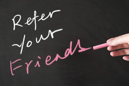 referral marketing: Refer your friends words written on the blackboard using chalk