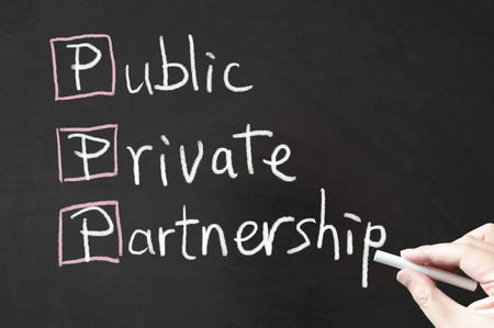 private or public: Public, Private and Partnership words written on blackboard using chalk