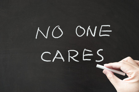 No one cares words written on blackboard using chalk