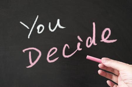 decide: You decide words written on the blackboard using chalk