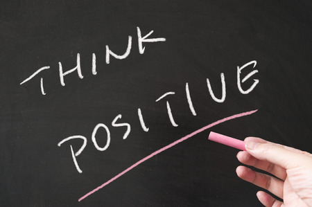 Think positive words written on the blackboard using chalk Stock Photo