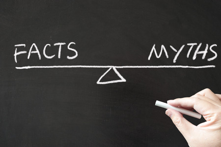 certainty: Facts vs Myths words written on the blackboard using chalk