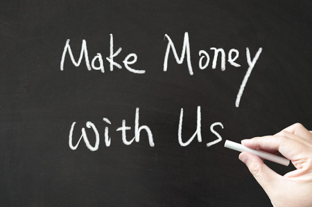 Make money with us words written on the blackboard using chalk