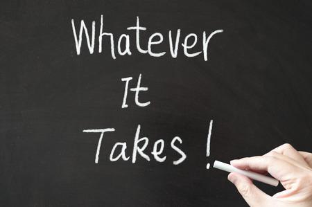 takes: Whatever it takes words written on the blackboard using chalk