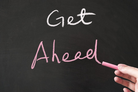Get ahead words written on the blackboard using chalk