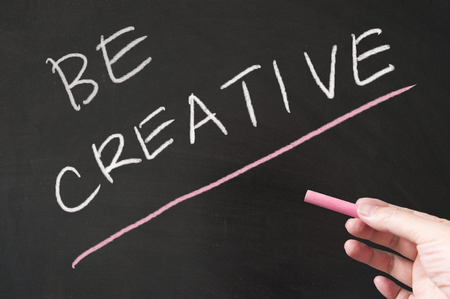 Be creative words written on the blackboard using chalk Stock Photo