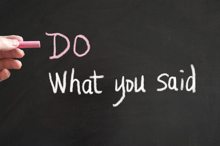Do what you said words written on blackboard using chalk