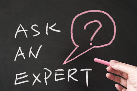 Ask an expert words written on blackboard using chalk