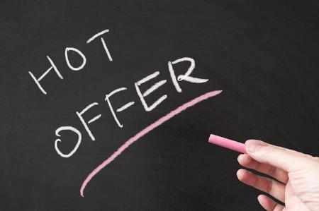 Hot offer words written on the blackboard using chalk