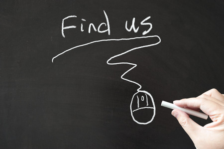 find us: Find us words and mouse sign drawn  on the blackboard using chalk Stock Photo