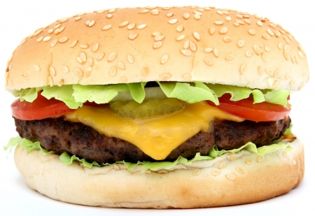 Cheese burger with lettuce cheese and tomato, isolated over white, macro, close up with copy space Stock Photo