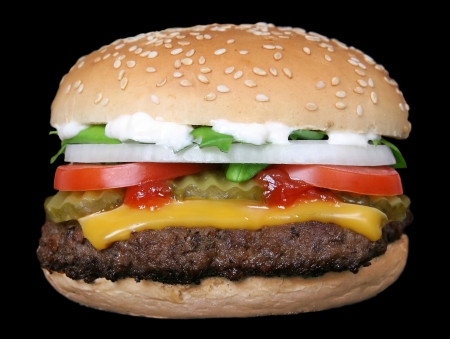 Silhouette of a cheese burger loaded with summer garden vegetables isolated on fire, macro Stock Photo - 17716799