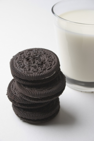 Chocolate sandwich cookies and a glass of milk