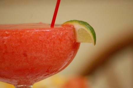 Strawberry daiquiri and lime with blur background
