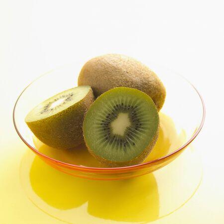 Halved and Whole Kiwi Fruit Stock Photo