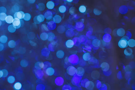 Abstract blue background. Blurred and defocused flickering Christmas lights