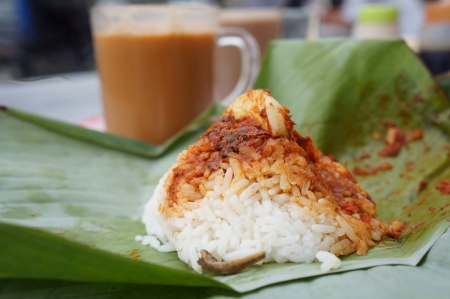 lemak: Local Malaysian breakfast nasi lemak and teh tarik  Stock Photo