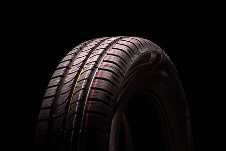 new summer tire all terrain. Close-up, black background Foto de archivo