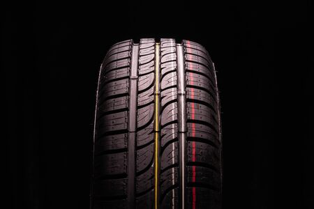 new summer tire all terrain. Close-up, black background