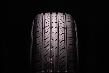 new summer tire, tire tread. Close-up, black background