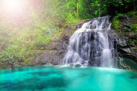 Tropical waterfall in the forest and mountain ,Ton Chong Fa in khao lak Phangnga South of Thailand. horizontal landscape, right