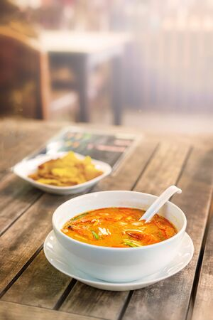Tom Yam Kung, Thai cuisine. on a wooden table. vertical photo.