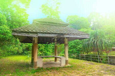 Wooden gazebo near the chong fah waterfall, Khao Lak,Thailand. green forest background