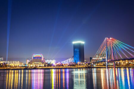 Evening and night Krasnoyarsk, panorama night city. Cable-stayed bridge in bright lights. Urban landscape. 写真素材