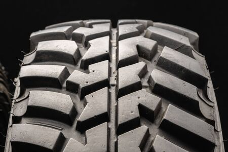 off-road tire protector from SUV class on a black background, close-up. Foto de archivo