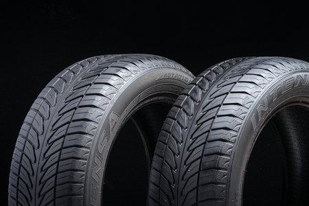 Krasnoyarsk, Russia, September 2: Two old summer tires used sava intensa on black background Editorial