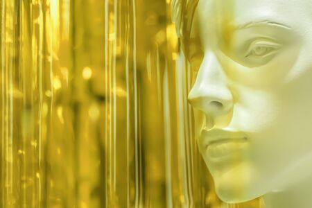 stylish beauty female mannequin head on a blurred colored yellow, background, light tinting. Good blank layout for fashion and beauty advertising. close-up, copyspace. fashionable and modern art