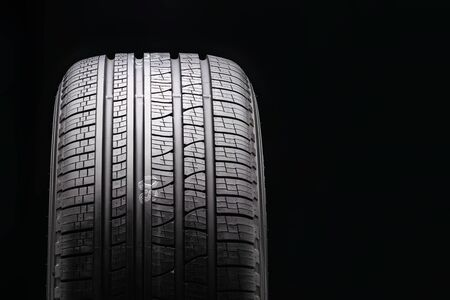 new black all-season premium tire. protector close-up. front view. copyspace