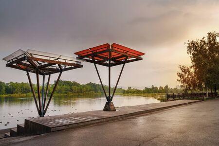 embankment of the Yenisei river, Krasnoyarsk. Beautiful gazebos and canopies verandah. Arrangement of the embankment. Urban design. Landscaping and beautiful evening view of the landscape