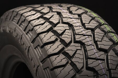 mud all terrain tires for SUVs on a black background close-up, emphasis on the wheel tread. Standard-Bild