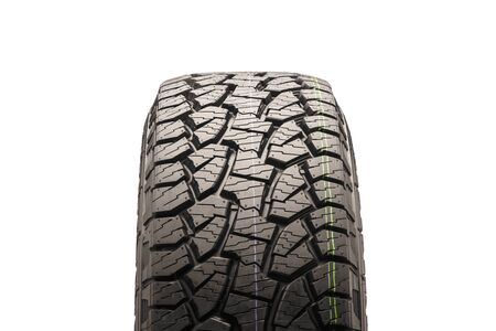 mud all-terrain tires for SUVs on a white background close-up, front view of the wheel, the tread is clearly visible. Isolate