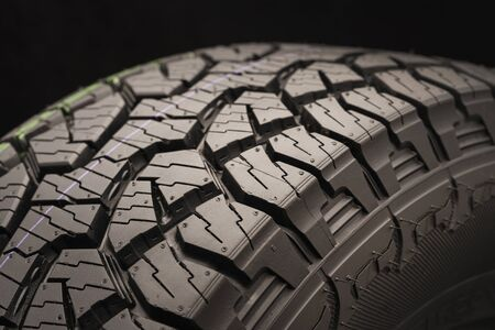 mud all terrain tires for SUVs on a black background close-up, emphasis on the wheel tread. a true conqueror of off-road terrain