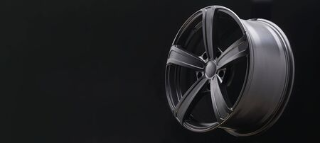 beautiful matte alloy wheels close -up on a dark background. Black and white drawing, auto tuning. copyspace long layout for design. Stock Photo