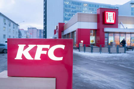 Krasnoyarsk, Russia, March 20, 2020: KFC restaurant, view of the building from the outside and a burning advertising sign. Winter