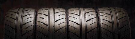 beautiful new summer tires with a directional sports tread pattern for auto racing and Motorsport. reddish fire background. tuning