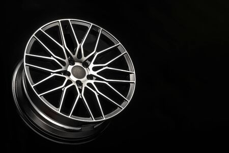 black alloy wheels, aluminum disc sport with a carbon fiber cover. Light weight and modern cool design. copy space maket Stockfoto