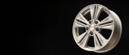 new aluminum alloy wheel, silver color on a black background. copy space