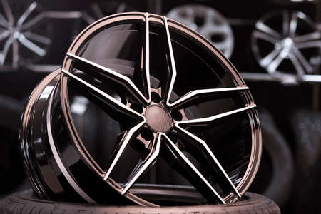 new alcoa alloy forged wheels in the car shop. sales of tires and wheels, automotive products. thin spokes and light weight, sporty design Stock Photo