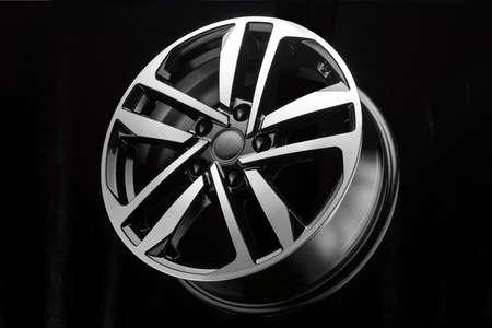 new shiny sporty alloy wheel black with polished finish on dark background