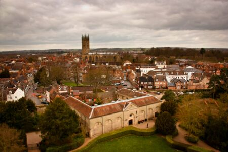 Tilt-shift aerial view of small European town buildings near London, England